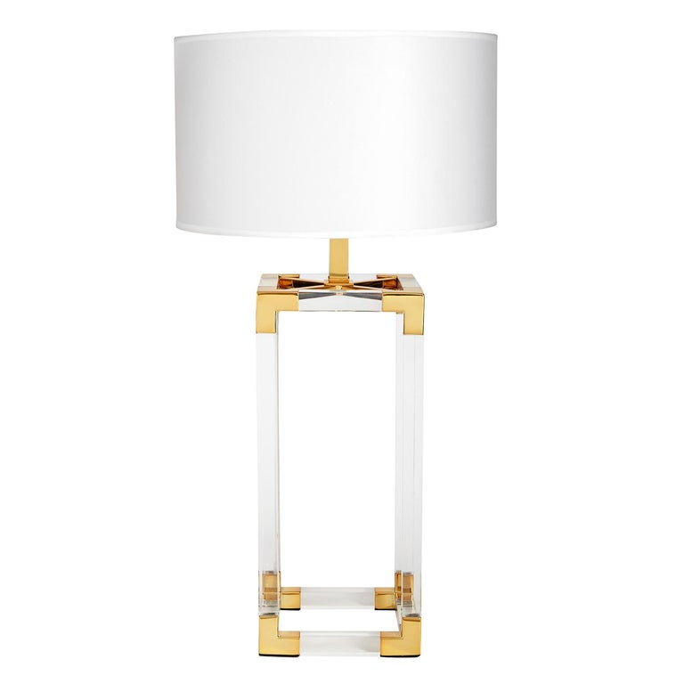 Clearly cool. The perfect blend of simplicity and glamour, modern and traditional. Our Jacques column table lamp features crystal clear acrylic framework with brushed brass corners topped with a silky white shade. Add some pop to your penthouse or