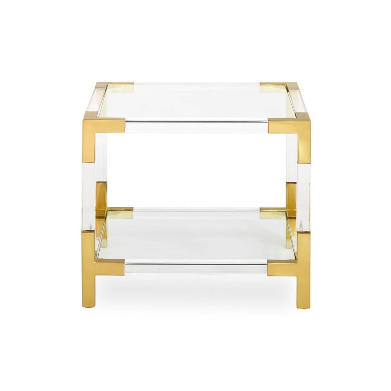 Clearly cool. Our Jacques collection is the perfect blend of simplicity and glamour, modern and traditional. In clear Lucite with brushed brass accents, this petite cube is perfect next to your sofa, by your bed, or saddled up next to your favourite