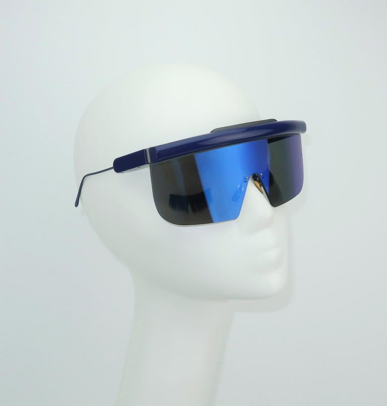 Jacques Marie Mage is a Los Angeles based designer of unique and limited edition eyewear including these handmade Italian space age style blue sunglasses.  This limited edition style (63 of a 200 count batch) is named 'Connie' after Halston's former