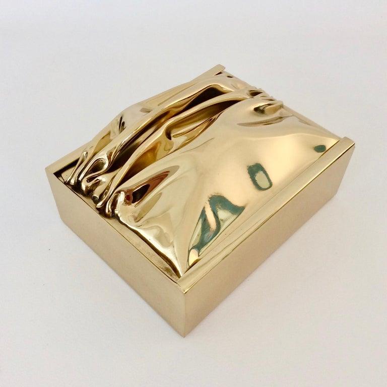 Nice Jacques Moniquet decorative box, circa 1970, France. Compressed polished brass sliding lid. Wood interior. Stamped edition Cheret AAM, Paris. Each piece produced by Moniquet is unique. Dimensions: 16 cm W, 9 cm H, 13 cm D. All purchases are