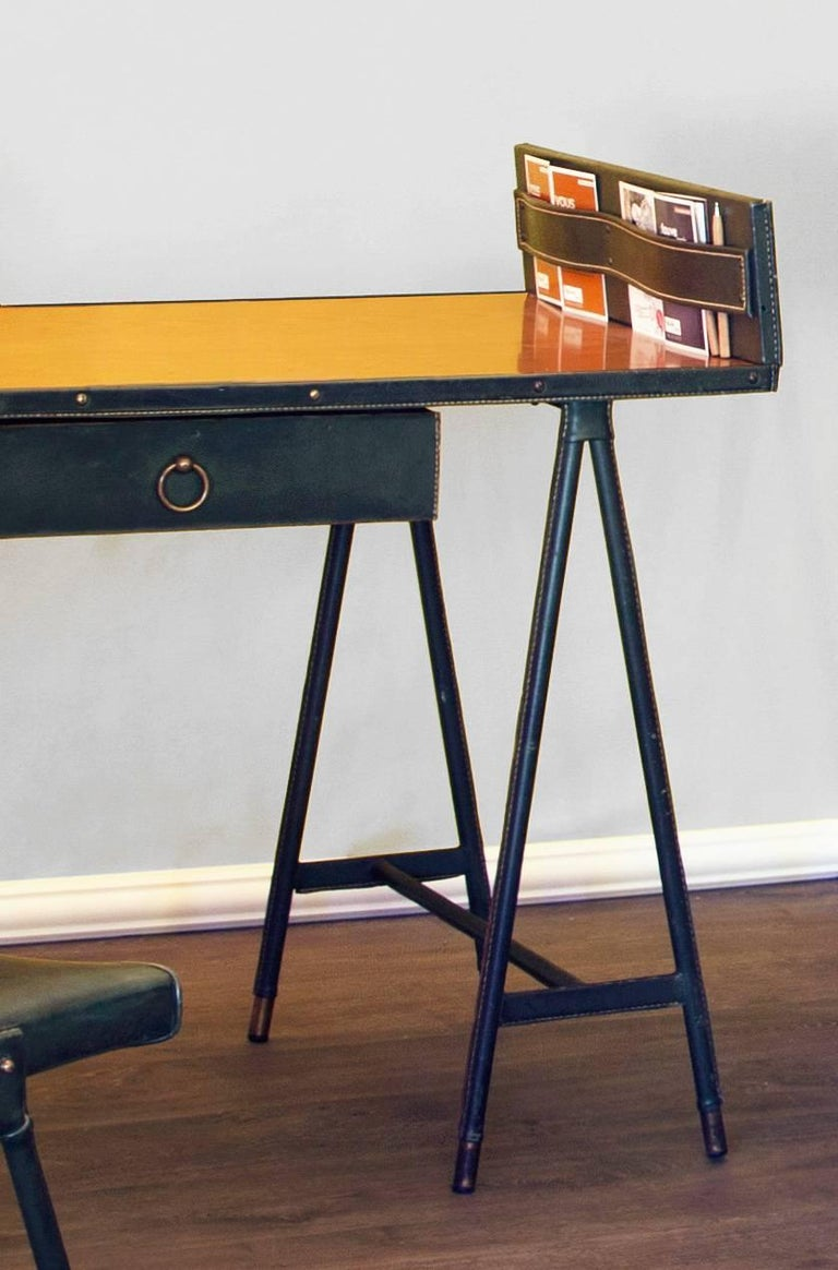 JacquesQuinet (1918-1992).  Very rare desk and its chair covered in green leather and vinyl. Saddle stitch - Pique Sellier. Brass hardware. Very rare model with storage on the right. This storage is used to store mail and paperwork but can be