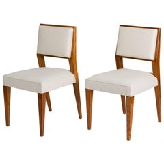 Jacques Quinet, Set of Eight Blond Mahogany Dining Chairs, France, circa 1950s