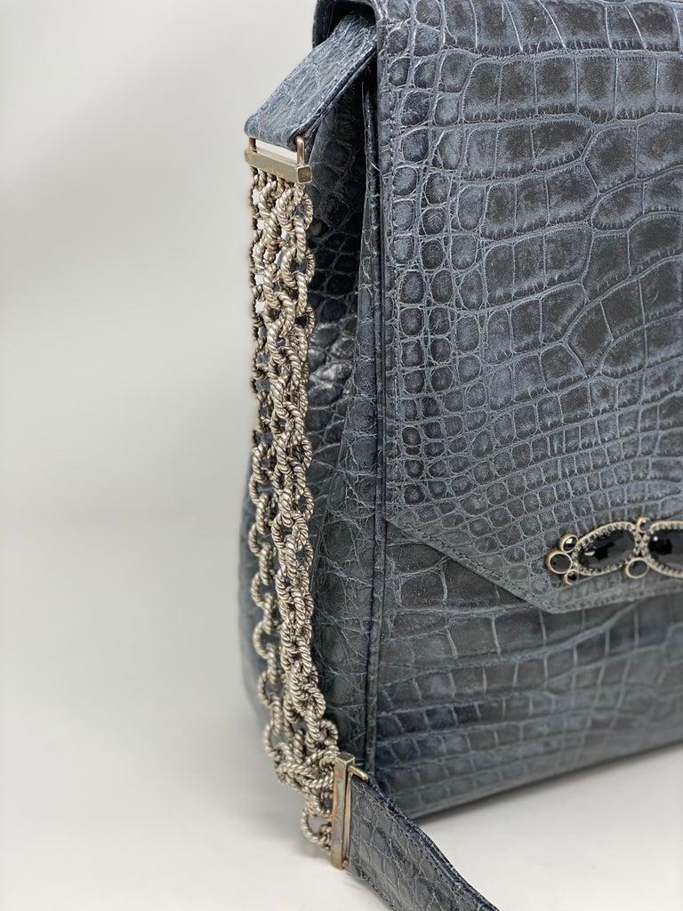 Jada Loveless Crocodile Bag. Beautiful jeweled handbag made of crocodile. Never used. Mint like new condition. Sterling silver chain. Guaranteed authentic.