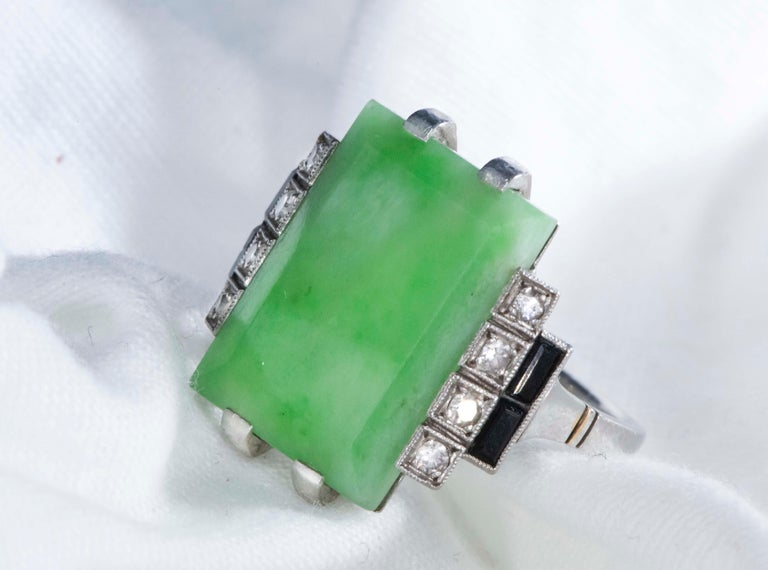 Specifications & Dimensions The present ring is a very impressive and sophisticated large 1920s French Hallmarked Art Deco Platinum Diamond Set  Onyx Green Jade ring.  The jade center stone shows excellent color throughout and the center stone