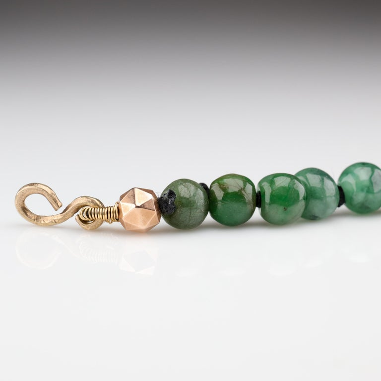 Each natural and untreated jadeite bead of this necklace was hand-carved. These beads were sourced from a small family business in Myanmar. They do small-scale mining of jade and instead of outsourcing the lapidary work to another country like