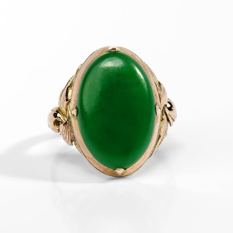 The lush emerald-green jade cabochon set into this hand-fabricated 18K yellow gold mounting is so evenly toned, so vibrant, and so fine that when I first saw the ring I instantly dismissed it as an imposter.