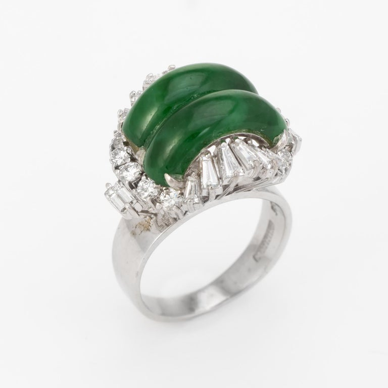 Elegant vintage jadeite & diamond cocktail ring (circa 1950s to 1960s), crafted in 14 karat white gold.   Cabochon cut jade measures 14mm x 5mm (each), accented with an estimated 0.78 carats of mixed cut diamonds (Round brilliant, straight and