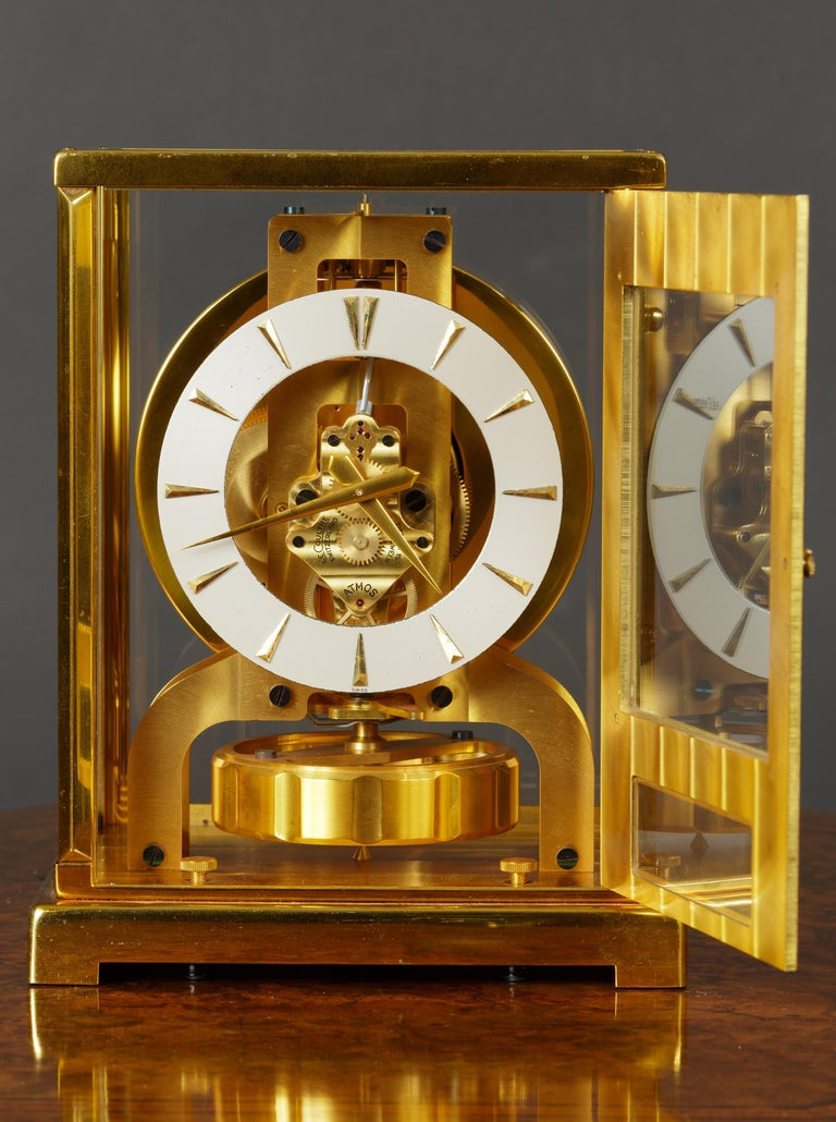 JAEGER LE COULTRE  Tuxedo Atmos clock with Ruby jewelled movement signed 'Jaeger Le Coultre'.  Silvered dial with baton numerals and original gold plated hands. Oscillating indented disc pendulum. Opening glazed front door.  Outstanding