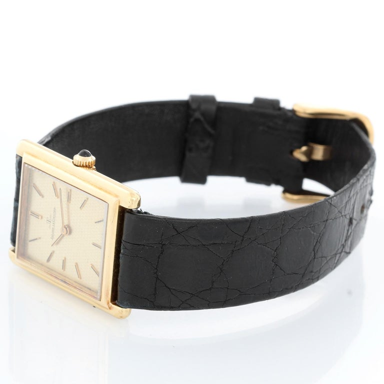 Jaeger Le Coultre  Vintage 18K Gold Square Mens Watch 6029.21 - Manual Wind. 18K Yellow gold case ( 24 mm x 32 mm). Rare Champagne pattern dial. Black alligator strap with tang buckle. Pre-owned with custom box .