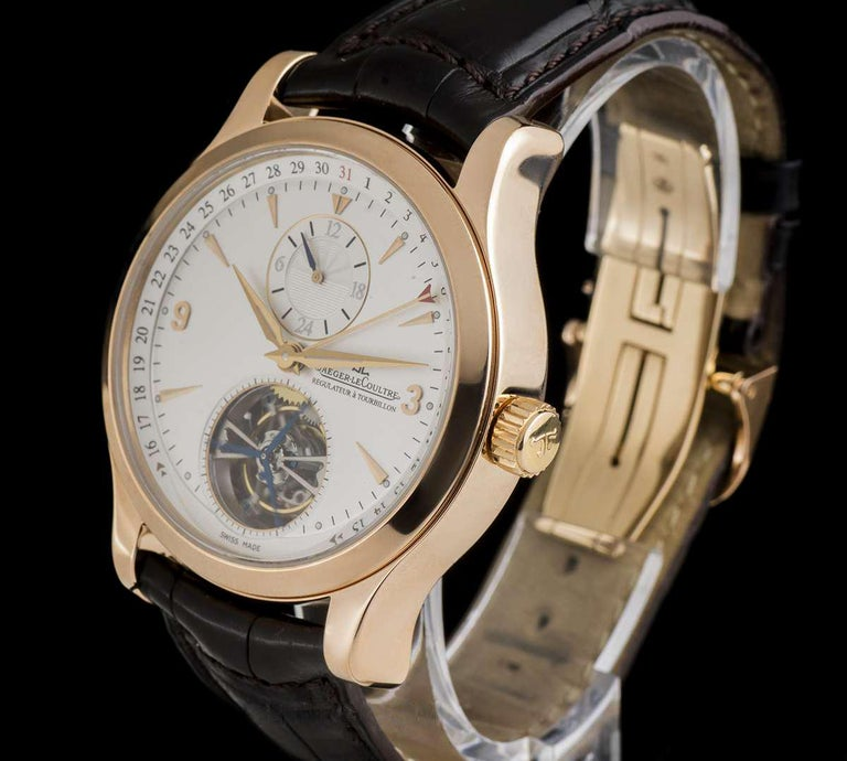 A 42 mm 18k Rose Gold Master Tourbillon Gents Wristwatch, silver dial with applied hour markers and applied arabic numbers 3 and 9, outer date ring with central hand, second time zone at 12 0'clock, a fixed 18k rose gold polished bezel, an original