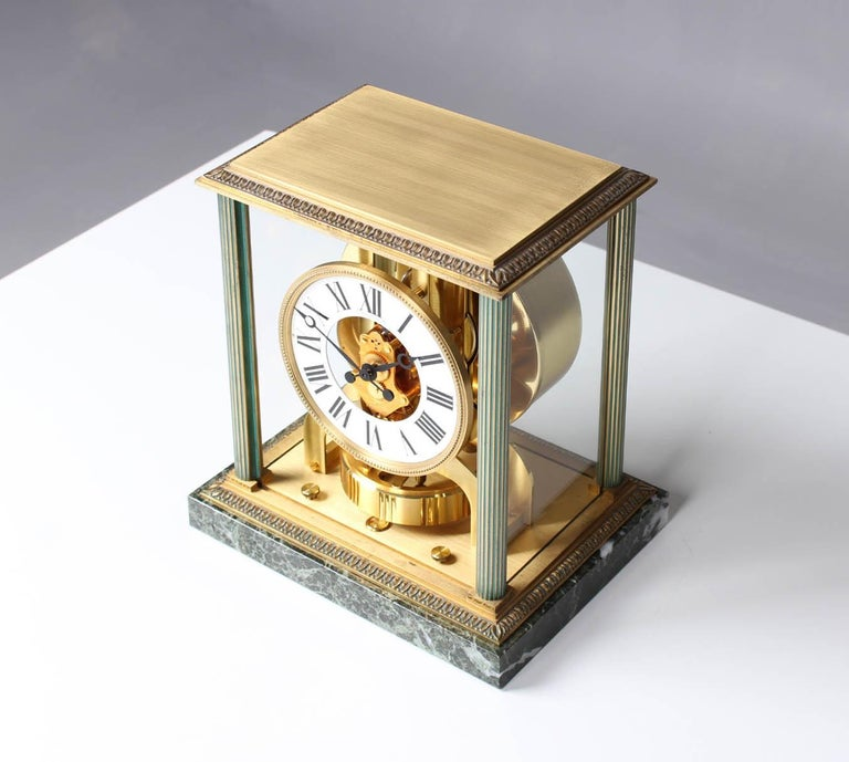 Atmos Vendome with original box  Switzerland Brass gold plated Year of manufacture 1968  Dimensions: H x W x D: 24 x 21 x 16 cm  Description: Atmos Vendome caliber 526. model number 5857 with marble base and fluted columns. White dial with