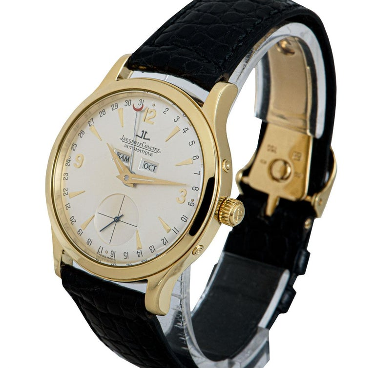 A 37 mm 18k Yellow Gold Master Date Gents Wristwatch, silver dial with applied hour markers and applied arabic numbers 3, 9, and 12, small seconds at 6 0'clock, day and month aperture at 12 0'clock, date display around the edge of the dial indicated