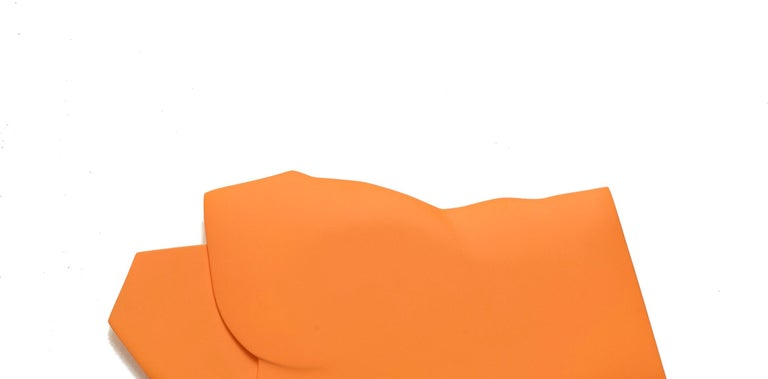 This orange piece is by Korean artist, Jaena Kwon. Her dimensional relief work is concerned with painting components and how painting space is constructed. She treats painting as an image objectified or embedded in physical material. Folding and