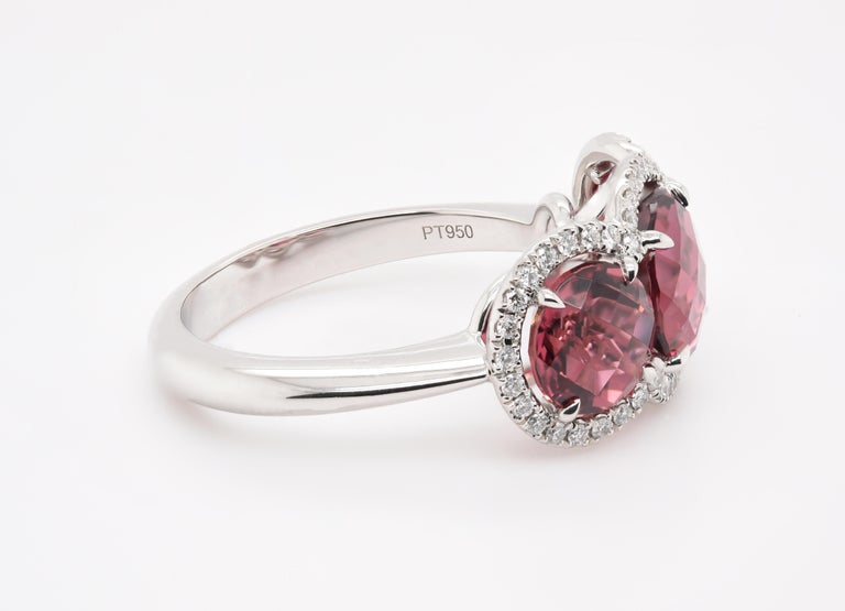 Round Cut JAG New York Three Pink Tourmalines Surrounded by Diamond halos Ring in Platinum For Sale