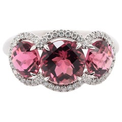 JAG New York Three Pink Tourmalines Surrounded by Diamond halos Ring in Platinum