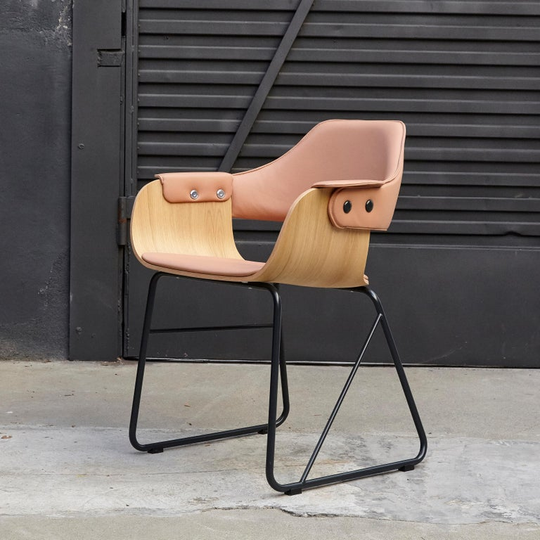 Design by Jaime Hayon, 2007 Manufactured by BD Barcelona.  Leather upholstered interior seat and backrest, with arms cushion. Measures: 52 x 55 x H.79 cm.  Painted metallic tubular steel structure. Seat and backrest in plywood.