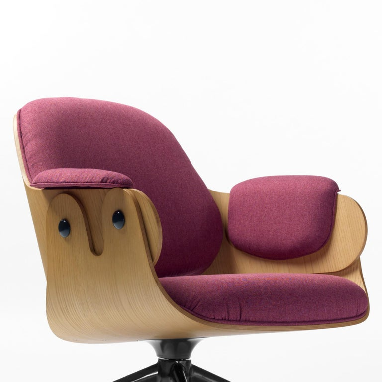 Armchair structure base in cast aluminium.  Structure base in tubular steel and painted. Seat, backrest are in plywood with exteriors in Ash - Stained oak FT18, and Fuchsia Y09 upholstery.  Various fabrics and leathers available.