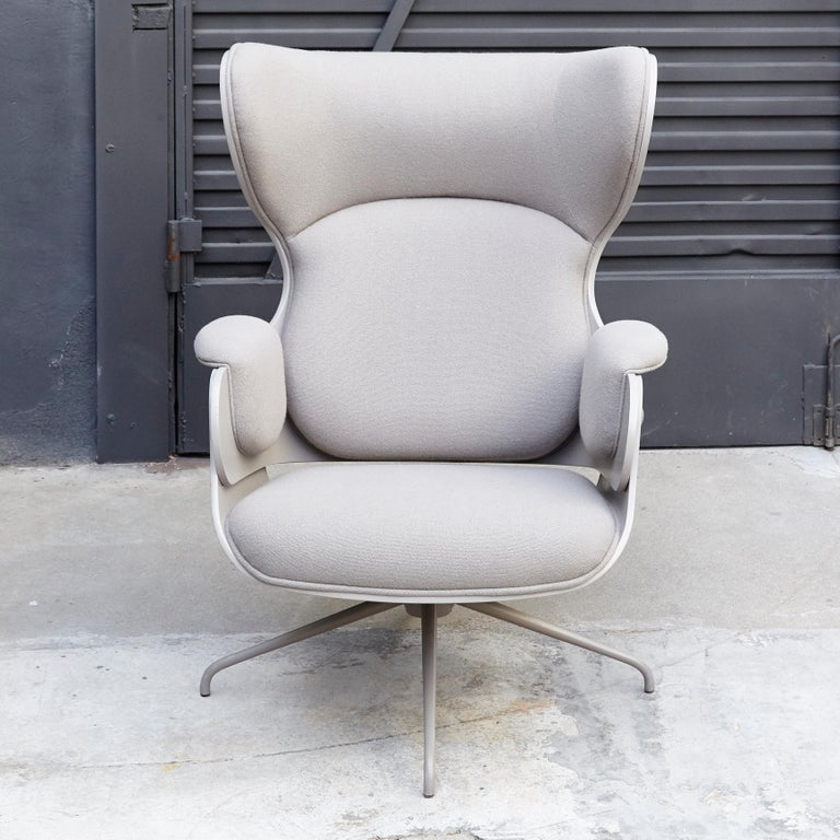 Armchair structure base in cast aluminium.  Seat, backrest are in plywood with exteriors in grey  Grey Upholstery.