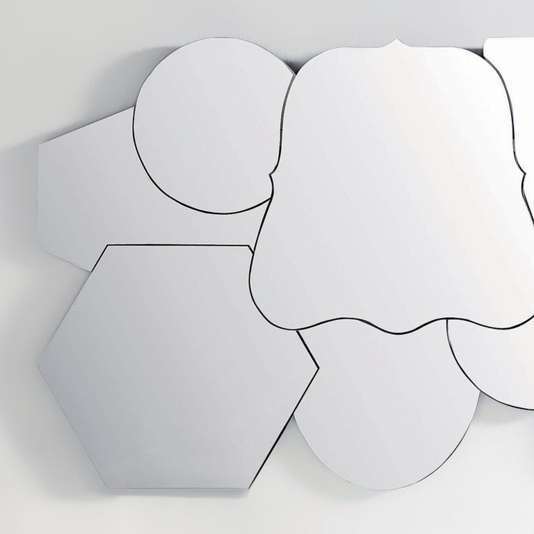Multimirror to a single faced composed of 8 mirrors of different forms and sizes. The back face of the mirror is always lacquered in matte black.  Measures: Mirror 1 729 x 582 x 5 mm  Mirror 2 Ø 461 x 5 mm  Mirror 3 735 x 637 x 5 mm  Mirror 4