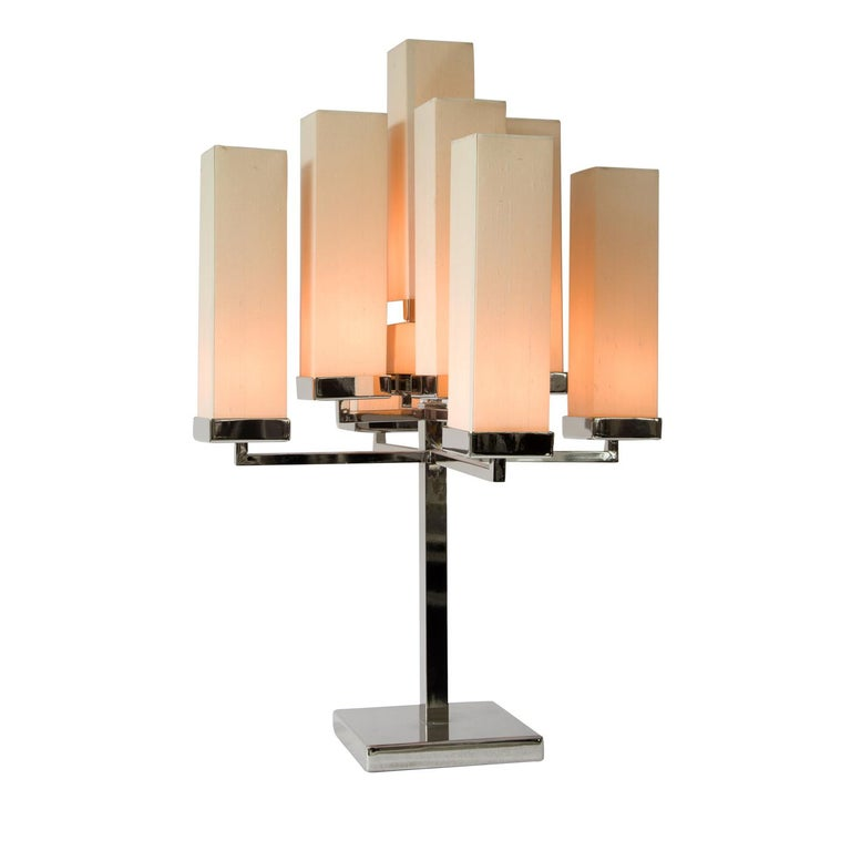 The magnificent Jaipur table lamp is a stunning example of soft and creative illumination. With 9 lights on a structure made from polished nickel, this delightfully innovative lamp makes a statement of elegance and style. The base is complimented by