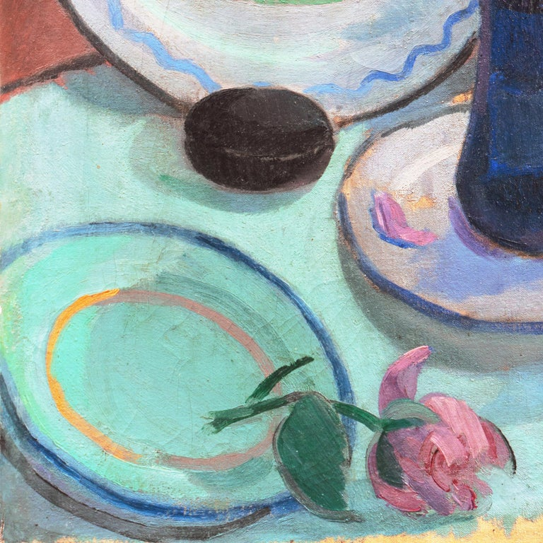 Signed lower right 'Jais' for Jais Nielsen (Danish, 1885-1961) and dated 1913.   An early twentieth-century, oil still-life of pink dog-roses shown loosely arranged in a cobalt blue glass vase, set beside two Breton tin-glazed earthenware plates,