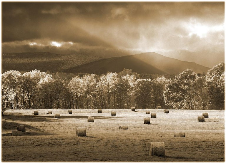 Hayfield and Catskills, NY , 2018 pigment print on watercolor paper, signed dated and numbered on face Available in 2 sizes: 13 X 16 1/4 edition of 25 $1,500.00  20 x 24, edition of 25 $2500  This Black and White Sepia-toned print of a Hay Field and