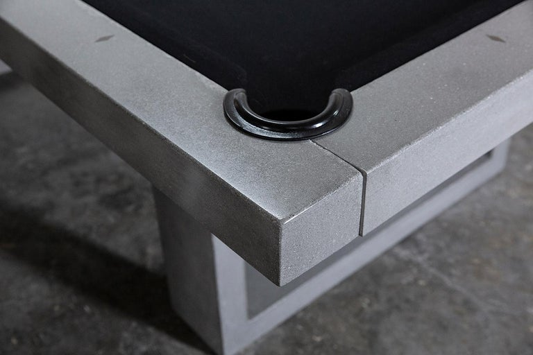The James de Wulf billiards table is a staple to any game room. The regulation sized table is constructed of concrete reinforced with carbon fiber. The elegant, yet brutal design is a pleasure to play on.  Tables are sealed with a unique finishing