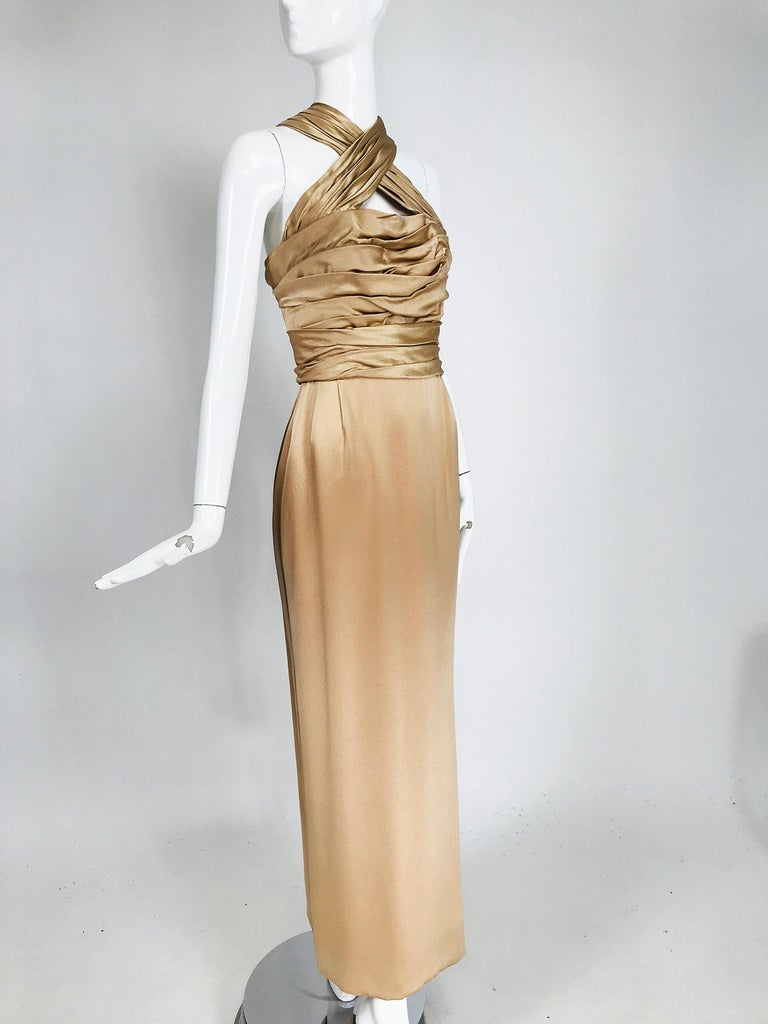 James Galanos champagne gold silk satin evening gown. James Galanos pale champagne gold hammered silk satin shirred bodice goddess gown from the 1990s. A sublime gown still modern and relevant with the construction of a master, something not always