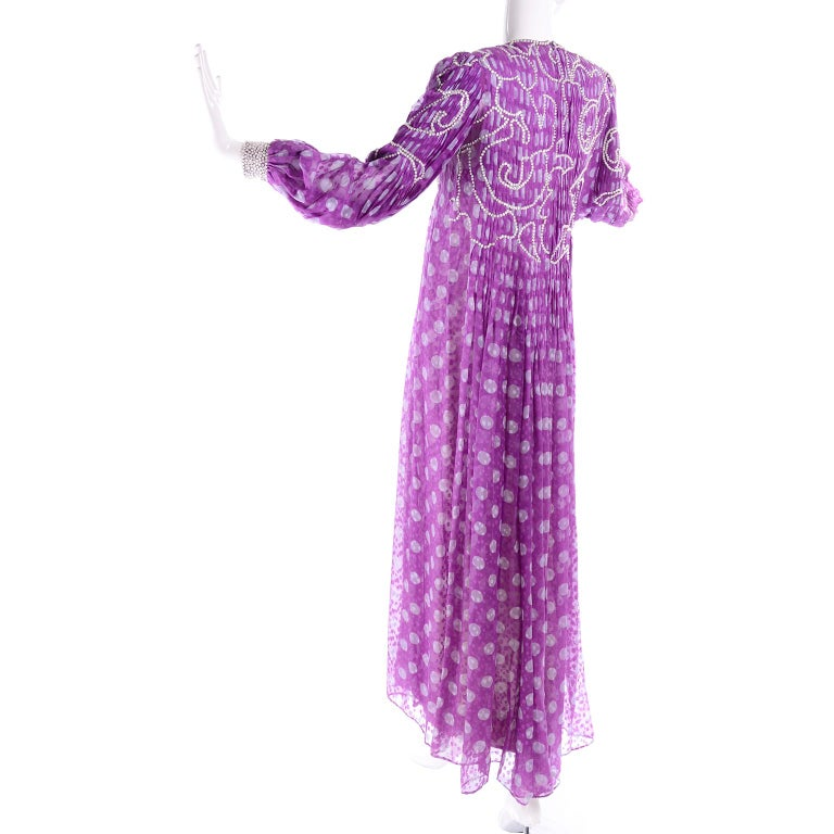 This is a sensational rare vintage James Galanos purple polka dot silk chiffon dress with silver beaded sequins and heavy pleats. The long sleeve semi sheer over dress has knife pleating held in place by swirling lines of sewn-in beads through