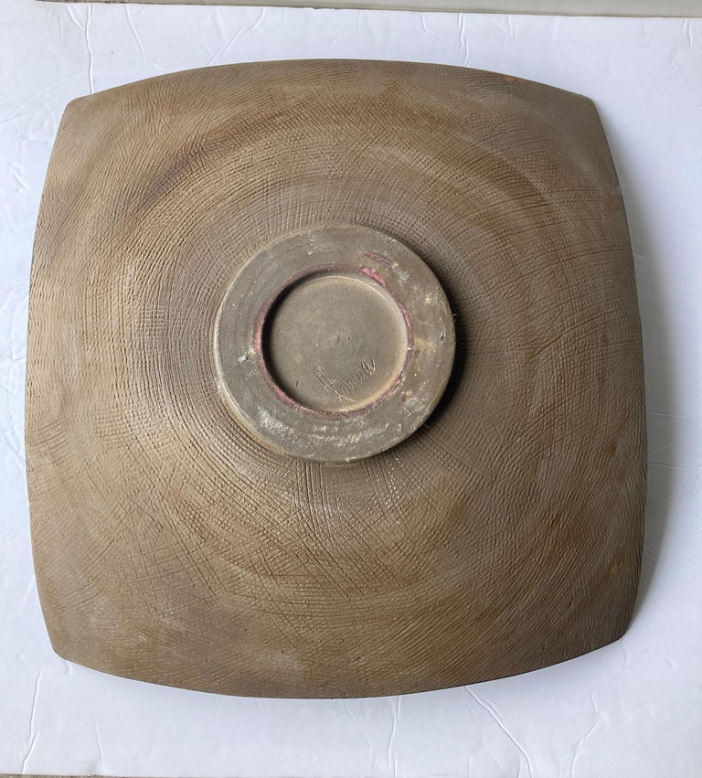 Very unusual square/round, shape centerpiece by the well known California potter. Has an olive green volcanic /lava glaze and brown under, signed Lovera. Note; one corner it goes as a hair 4 inches high.