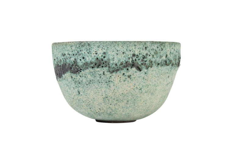 James Lovera Studio pottery bowl in a green crater glaze. Signed.
