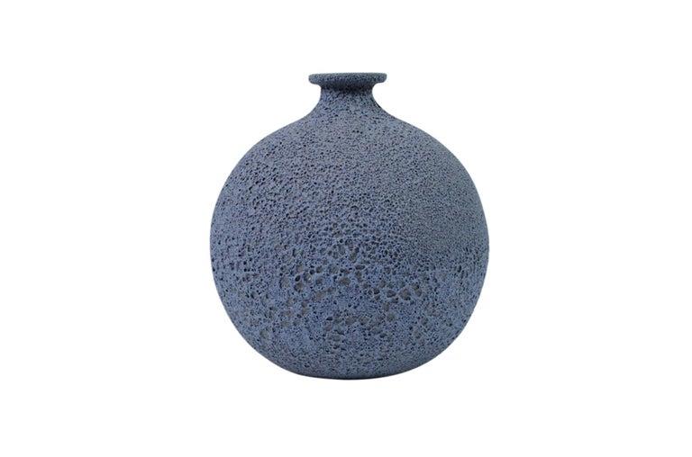James Lovera bottle vase in bright blue crater glaze. Signed.