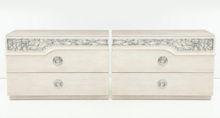Pair of mint restored bleached/cerused oak dressers with chinoiserie inspired carved bamboo trim with an aged silver leaf finish. Stamped James Mont Designs.  Each chest has 3 drawers.
