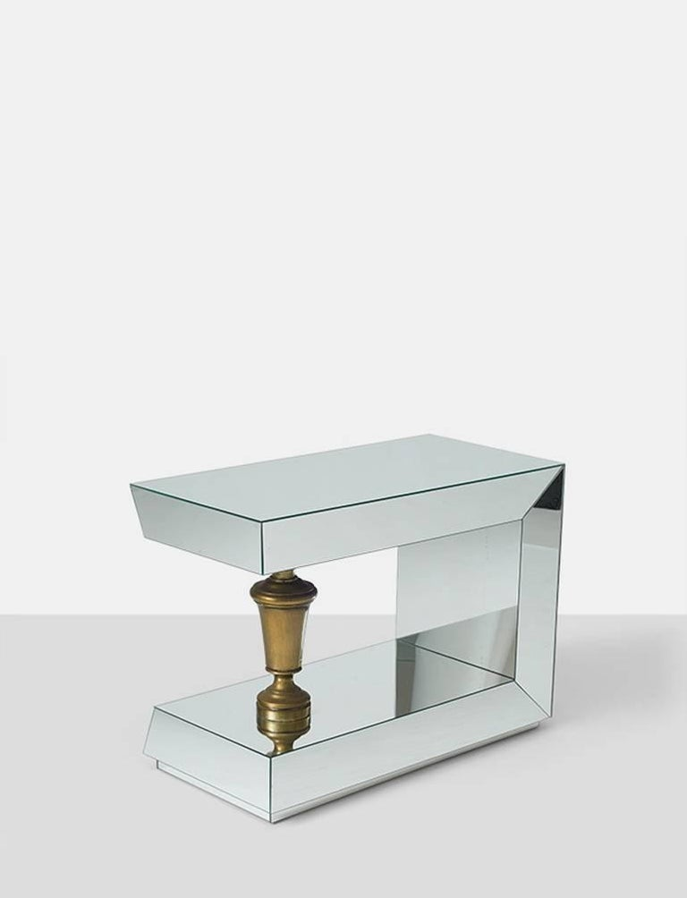 A pair of end tables by James Mont. Fully mirrored with a brass urn shaped support.