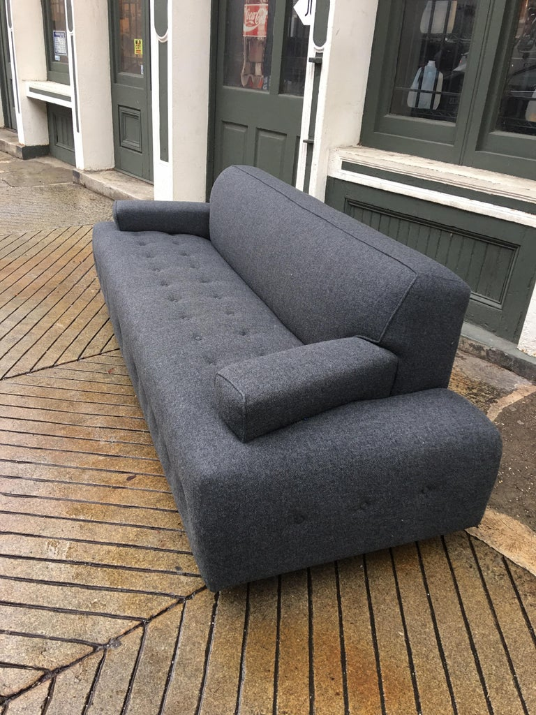 James Mont style sofa upholstered in a charcoal gray wool blend. Probably from the 1940s or early 1950s in design, but completely redone 8 years ago. Still in near perfect condition! No stains or fading. Was professionally cleaned 5 years ago and