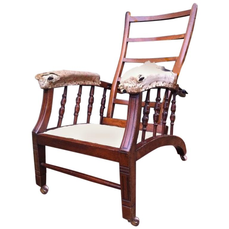 James Shoolbred, Morris & Co Style, an Aesthetic Movement Reclining Armchair