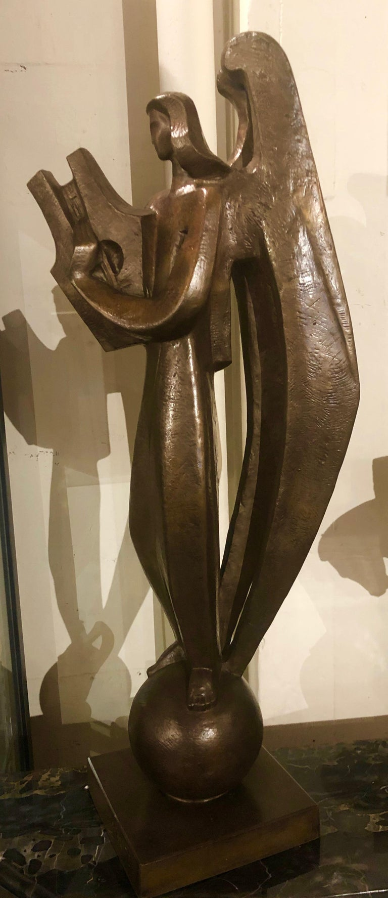 Original bronze by Jan and Joel Martel. Image of a stylized cubist Angel playing a harp.. Rare and famous figurative bronze made by Susse Frères foundry cast posthumously from the original with permission of the family in 2002. Signed:
