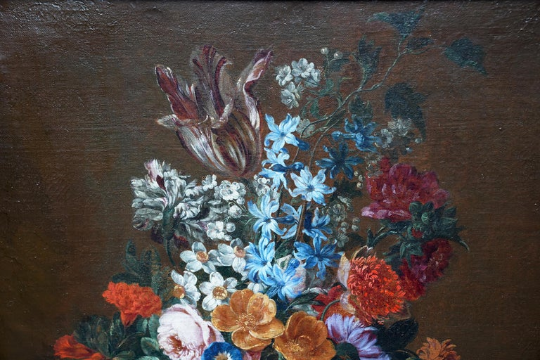 This stunning Golden Age Baroque floral still life oil painting is attributed to the circle of Jan Van Huysum. It is actually part of a pair of paintings in beautiful matching fames and with excellent provenance, a previous owner being Rothschild.