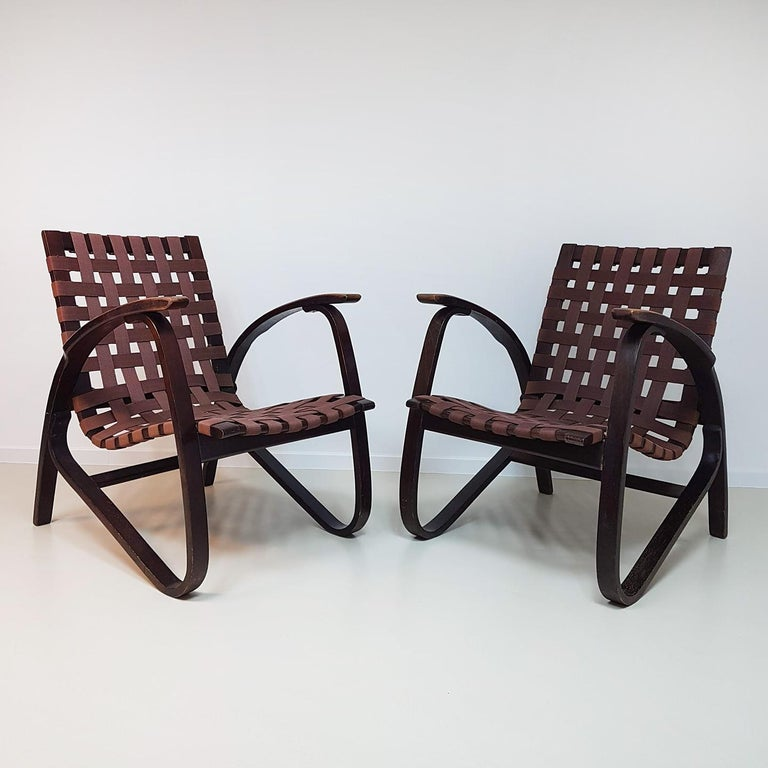 Stunning pair of black bentwood armchairs by Vanek for UP Zavodny, Czech Republic, 1930s. With brown woven original strap seats, and a elegant bent wooden frame. 