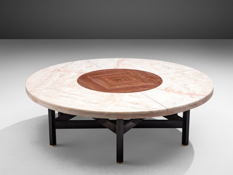 Jan Vlug, cocktail table, wood, marble, travertine and brass, Belgium, 1970s.  Exclusive coffee table with characteristic graphical base and round stone top. The base, made of dark lacquered wood, consists of six legs, formed into a star-shape.