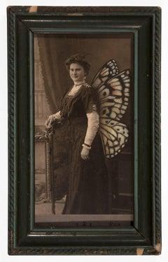 untitled (butterfly woman by window)