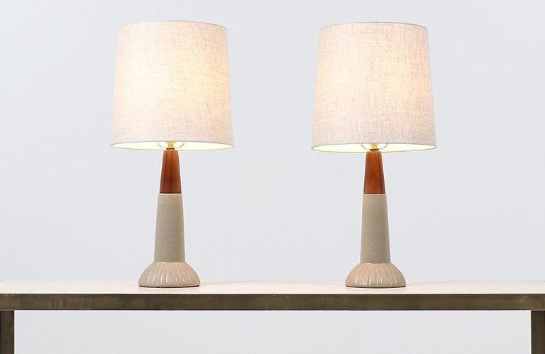 Jane & Gordon Martz ceramic table lamps for Marshall Studios   Dimensions 25in H x 6in W x 6in D  Lamp Shade: 11.5in H x 12in W.