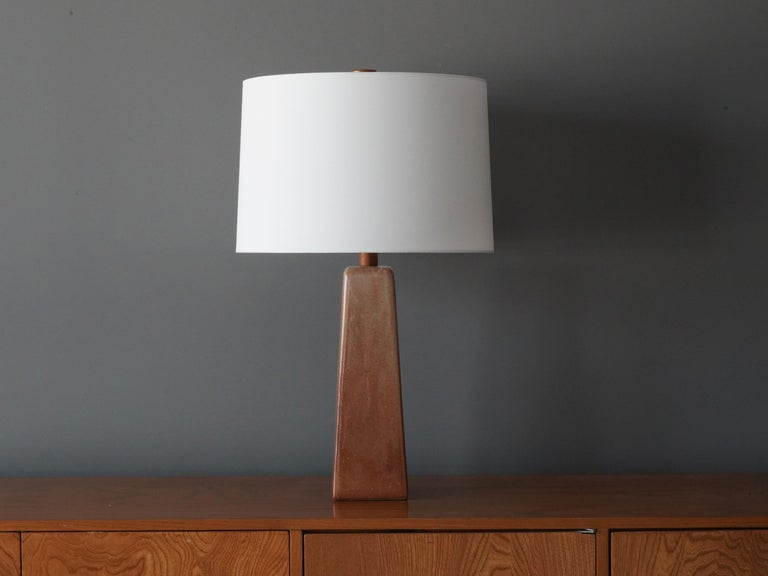 A table lamp designed by husband and wife duo Jane & Gordon Martz. Produced by Marshall Studios, Indianapolis.   Base is slip-cast and then dipped into glaze. Design also incorporates exquisite walnut neck and finial. Base is signed.  Jane &