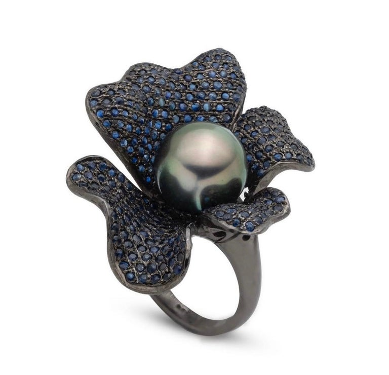 Jane Magon Collections Tahitian Pearl and Pave Blue Sapphire Ring set in Black Rhodium Sterling Silver. The Tahitian Pearl measures 11mm and is Fine Quality with a Green and Rose Overtone, no blemishes. The Sapphire weights are approximately 2.00ct