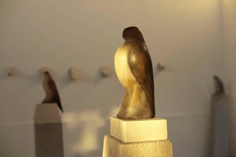 Hand blown pigmented glass and limestone.  From the artist's studio. Bird:  16
