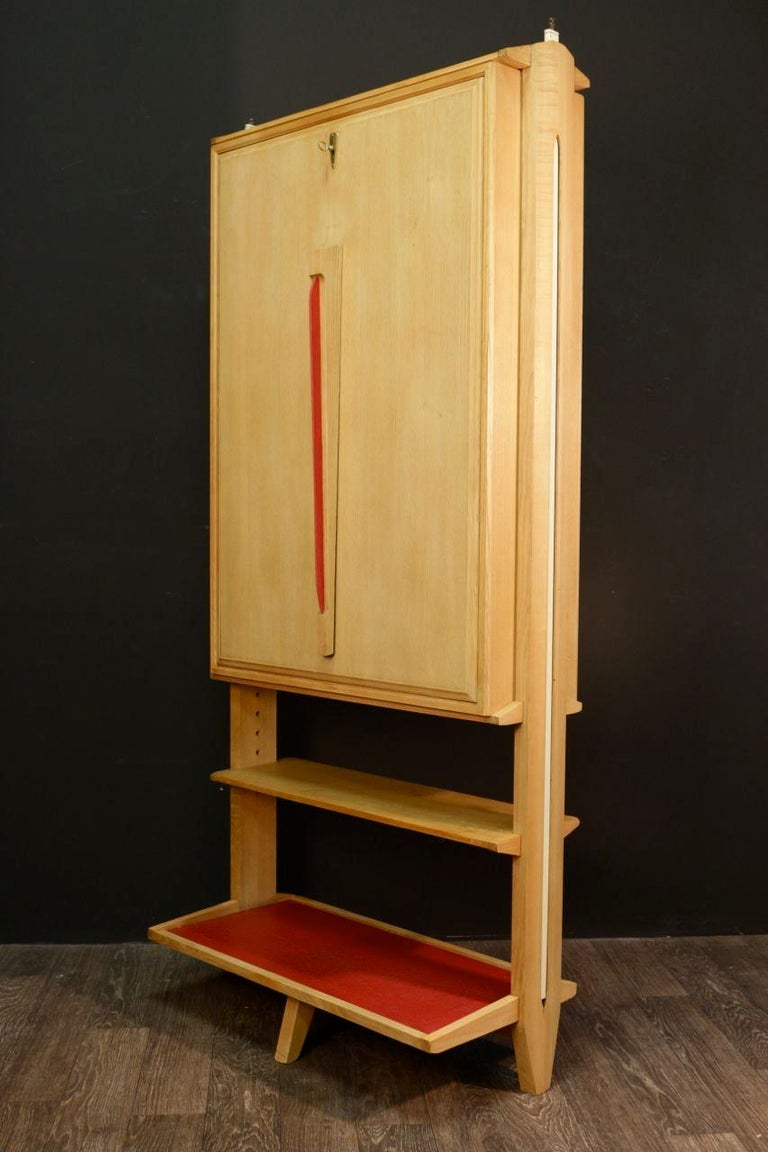 Bureau in steps of Maurice Pre and Janette Laverrière 1958 in blond oak embellished with red skai of origin, the opened flap serves as office, small library, a system of side rack makes it possible to adjust the cremones to the height of the