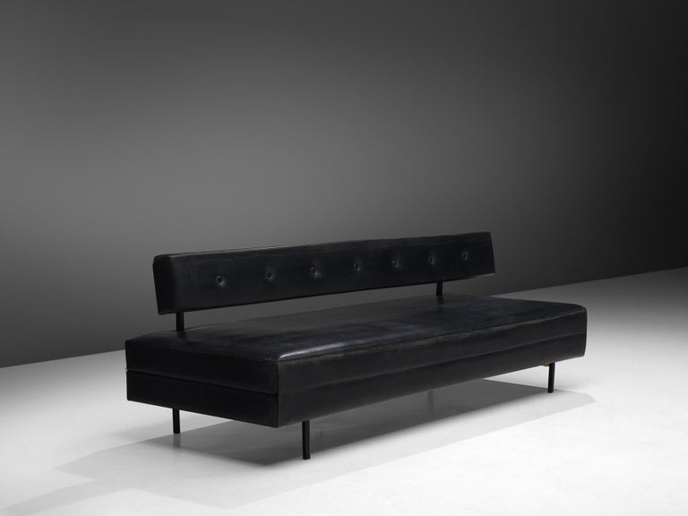 Janine Abraham & Dirk Jan Rol, daybed, steel and black leatherette, France, 1962.  The sofa AR-1 by Janine Abraham and Dirk Jan Rol was designed for Les Hughes-Minvielle in the early 1960s. This canapé folds into a double bed. The design