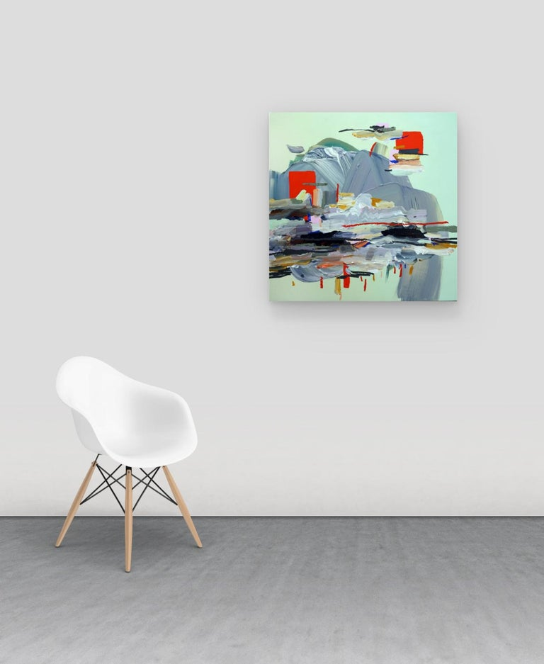 Conditioned By Gravity is a square, multicolored abstract painting set against a light mint green background. This is a striking painting full of movement by an emerging Canadian artist. The painting is on a birch panel and can be installed in any