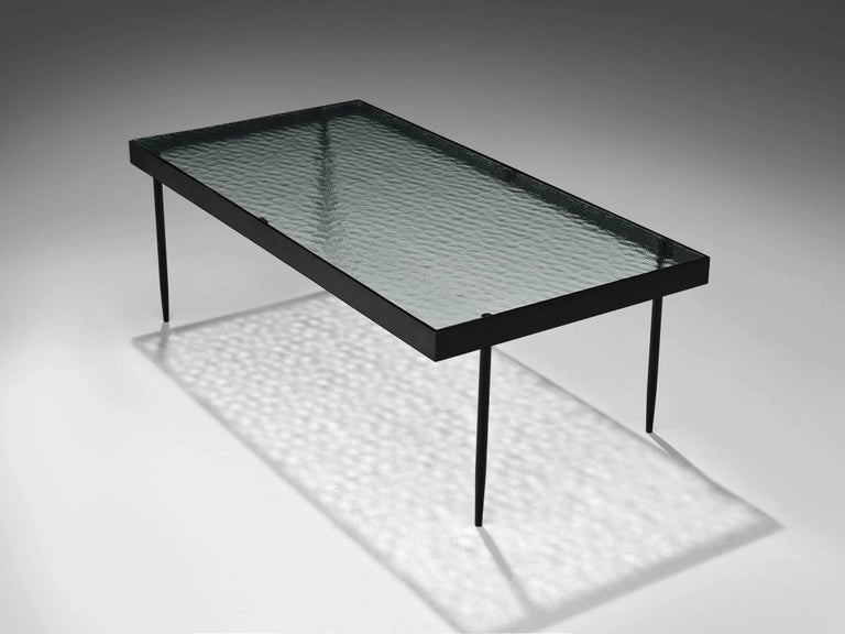 Janni Van Pelt for Bas Van Pelt, coffee table, glass, metal, Netherlands, 1958.   This is a rare rectangular coffee table is designed by Janni Van Pelt for Bas Van Pelt. The table is made from reinforced glass with delicate tapered legs and a