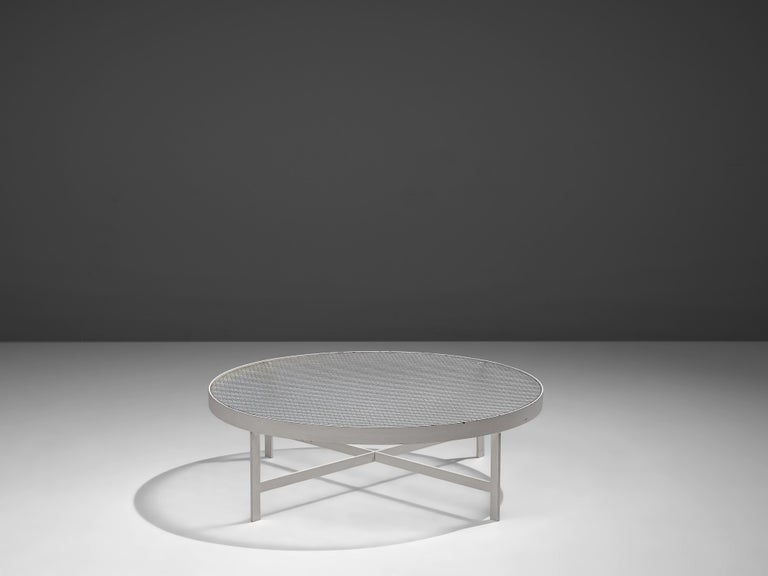 Janni Van Pelt, coffee table, glass, white metal, the Netherlands, circa 1958   Round coffee table in white coated metal and wired glass. This table is a variation of Janni Van Pelts model M419. The base consists of four flat legs with a